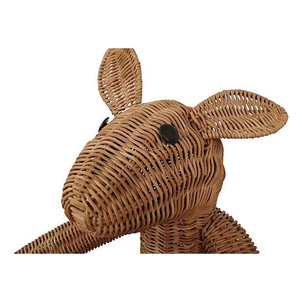 "Whimsical rattan kangaroo basket. Great use for children's toys or other types of storage. Dims: 14.85"" L x 14"" W x 26"" H"