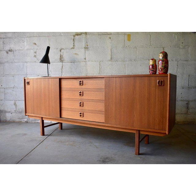 Exceptional Mid Century Modern Danish credenza / sideboard. Perfect layout for a media stand - generous shelving for...