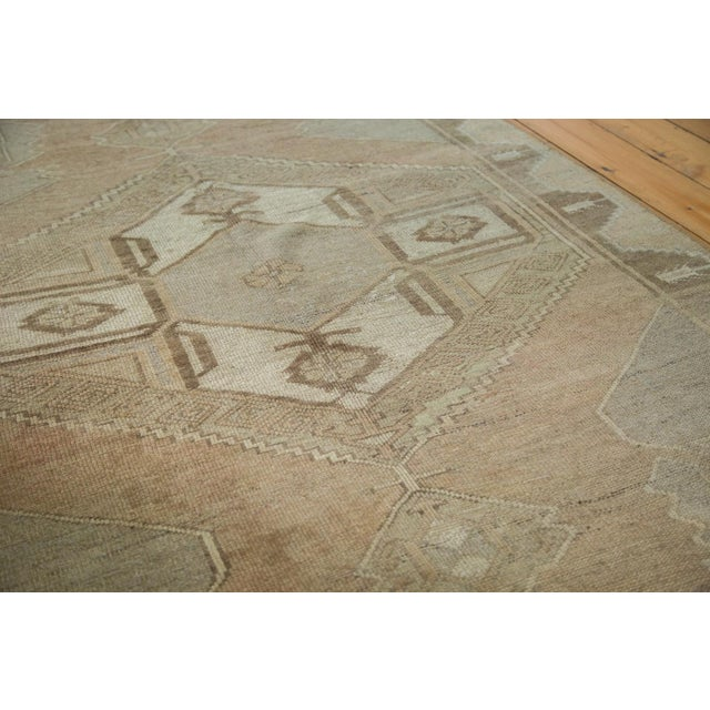 Geometric vintage oversize Oushak runner with large scale geometric simplistic renderings mainly the two medallions in the...