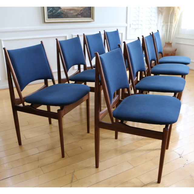 Smooth Teak dining chairs set of 8. Gorgeous Original Navy Blue upholstery appears to be fairly new and is in good...