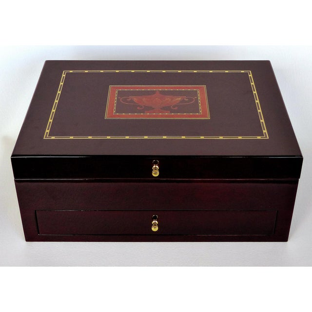 Offered for sale is a Reed & Barton lined silver chest with marquetry details in the American 18th century style.