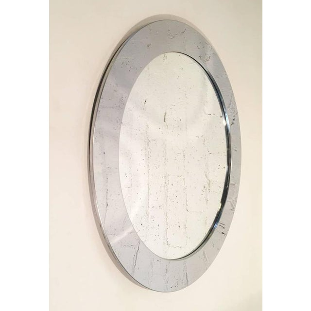 A chrome round mirror designed by Curtis Jeré for Artisan House in the 1970s. It's not signed but it retains the Artisan...