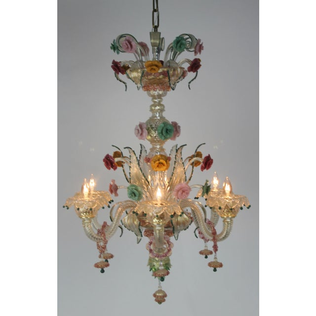 This chandelier is simply amazing. Hand made Venetian glass with gorgeous color and intricate detailing. There are no...