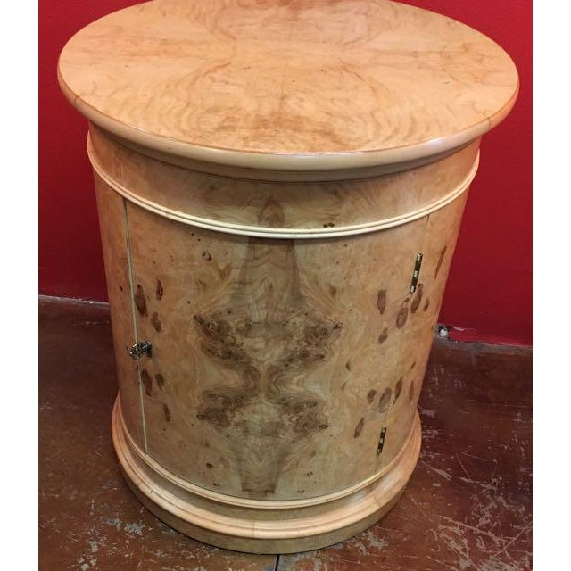 Vintage Henredon drum table/ round cabinet finished in book matched olive burl veneer. The burl pattern is repeated 4...