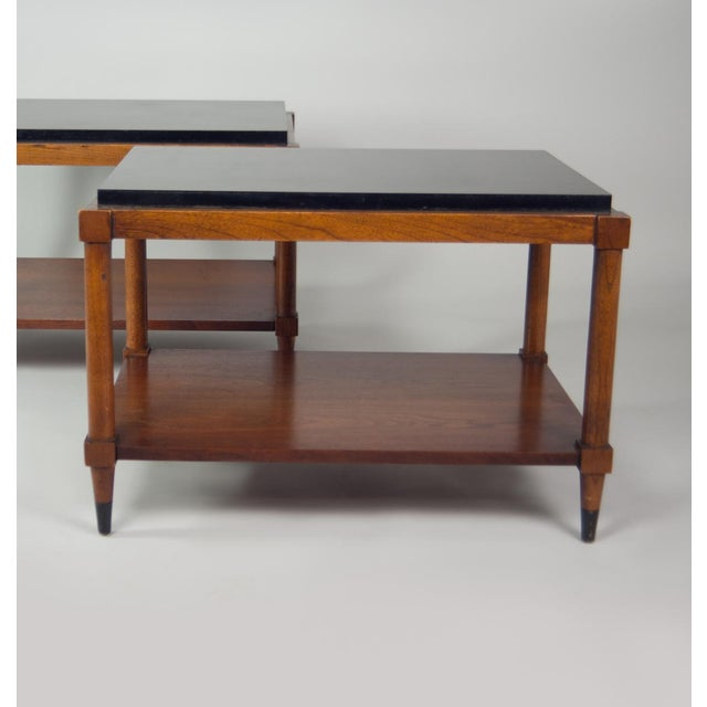 Tiered side table with black laminate top, walnut base and black sabot. Listing is for one table.