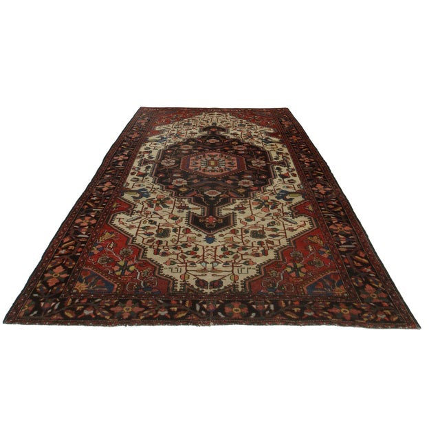 Antique Persian Serape rug. Hand-knotted from wool. Features a medallion design.