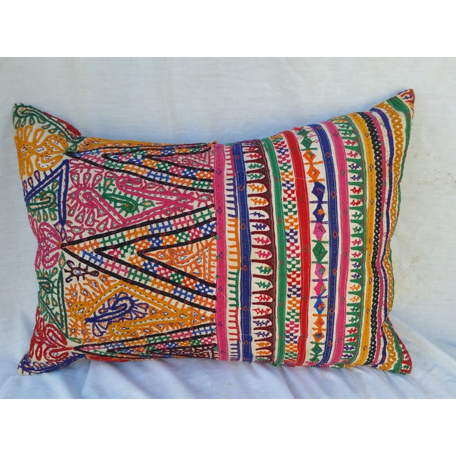A vibrant pillow made from an original 1960's camel sack. Made by the nomadic people of Rajasthan India. Hand embroidered...