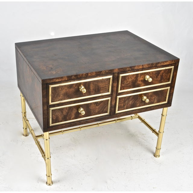 By Mastercraft, a solid brass faux bamboo stand, newly polished and lacquered with a handsome burled wood chest. The chest...