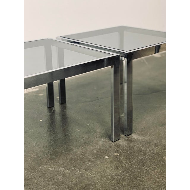 Twin chrome rectangular tube frames host a square sheet of dark smoked glass. They are equal squares and can be used to...
