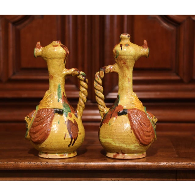 Bring colors to your kitchen with these antique glazed oil pitchers; created in Turkey, circa 1920, each colorful pitcher...