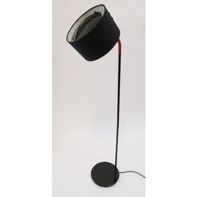Modern floor lamp with adjustable black fabric shade and black metal defuser. Shade and rubber neck fully adjust up and down.