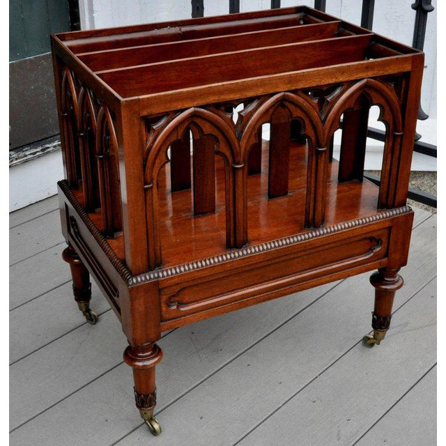 This listing is for a rare English Regency Neo Gothic mahogany magazine rack. -Fully carved Gothic arches on all sides and...