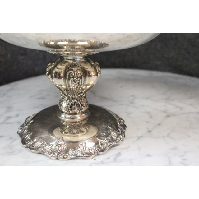 Silverplate Reed and Barton compote with serpentine rim with raised decoration.