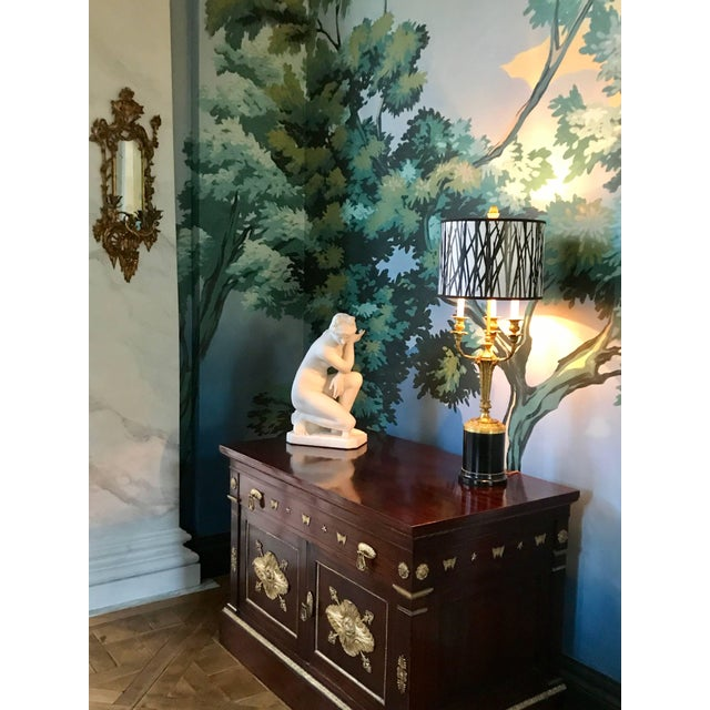 A wonderful pair of Rococo chinoiserie giltwood two-arm wall sconces is carved in the manner of Linnell. In a whimsical...