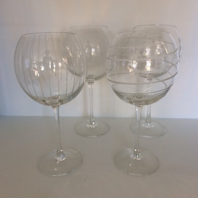 Great set of Mikasa crystal balloon wine glasses that have been etched with contemporary designs. Great set in perfect...