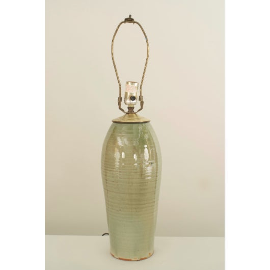 American Mission Arts and Crafts style celadon porcelain table lamp with a cylindrical shape and horizontal ribbing