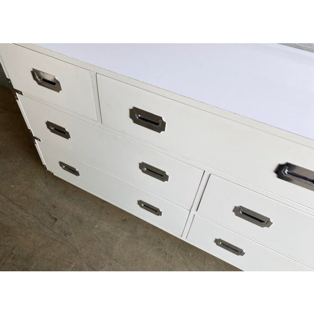 Fabulous vintage Dixie Campaigner white dresser. Marked on the drawer inside. Laminate top with wood body. Chrome hardware.