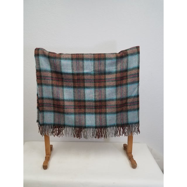 Wool Throw Red Blue Orange Plaid - Made in England A versatile throw in a plaid design. The colors are red, blue and...