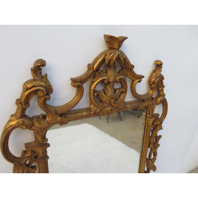 Italian 2 gold gilt mirror carved with leaves and scrolls.