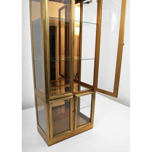 Beautiful 1970's Mastercraft Brass Vitrine. Cabinets are in excellent condition with only a few small chips in the corners...