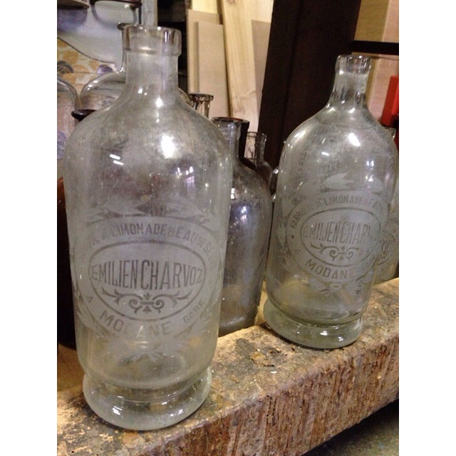 These bottles are very heavy glass, etched with a beautiful lemonade label. Perfect size to be used as a carafe, vase or...