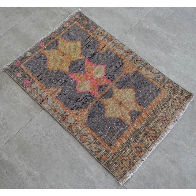A vintage Turkish small yastik rug, rum (dark mulberryish gray) background color yastik rug perfect for entryway, bath or...