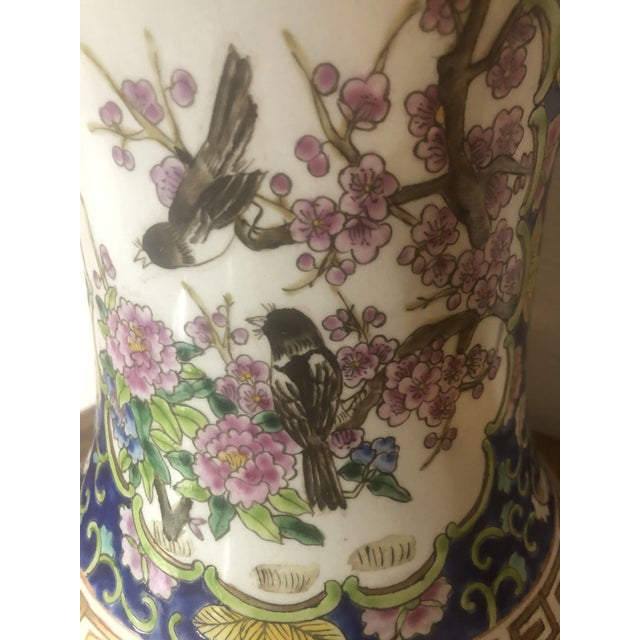 This is a beautiful chinoiserie cachepot made in the People's Republic of China, so we know that it was made after 1949....