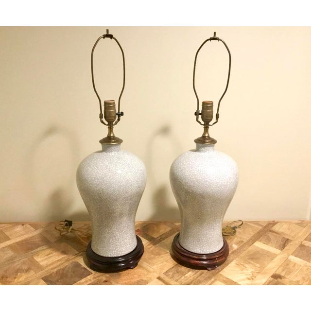 Stunning pair of well constructed crackle glaze lamps made from Chinese porcelain vases. The base color is a greyish blue...