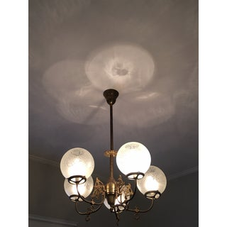 Antique 5 Arm Gilt Scroll Pattern Metal Chandelier With Etched Floral Designed Round White Globes Preview