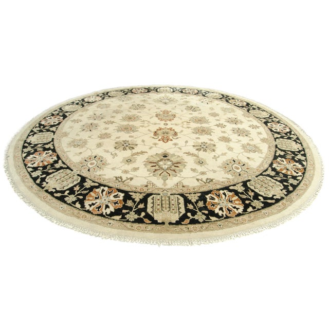 Offered is a hand-knotted Turkish style Kalaty Oushak large round carpet with an all over floral design. A contemporary...