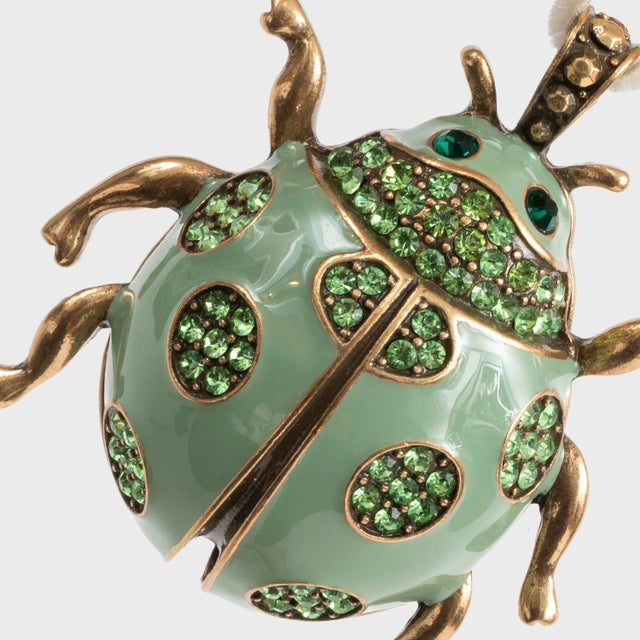 I adore the idea of pastels at Christmas... and this ladybug hanging ornament is just the right shade of mint! Ladybugs...