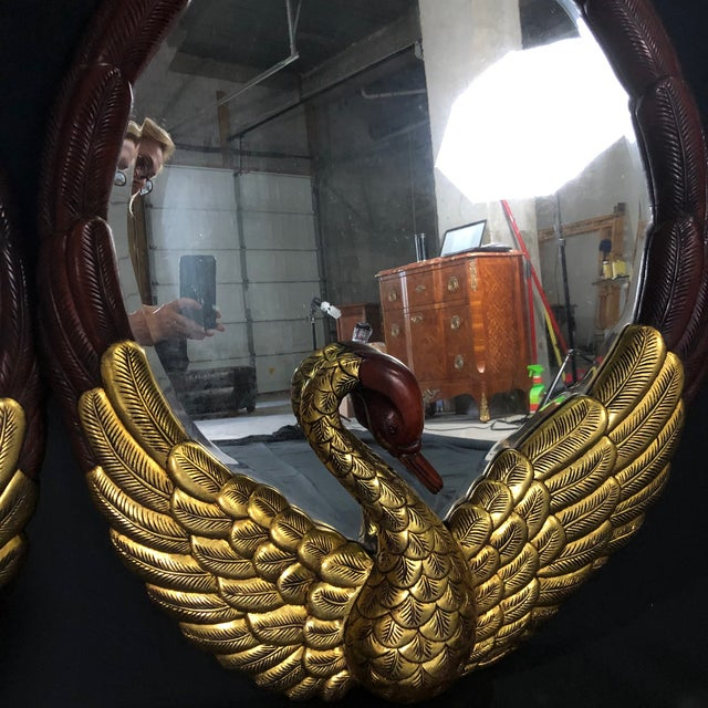 Absolutely stunning pair of carved mahogany large oval mirrors with swan figures at the base of each mirror. Detailed...