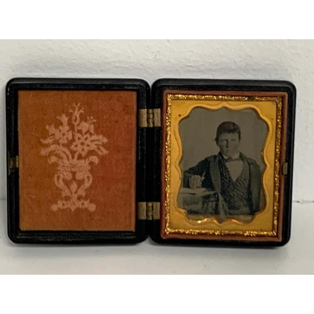 19th century ambrotype of a young male student/ writer, gutta percha case An unidentified well dressed standing young man,...