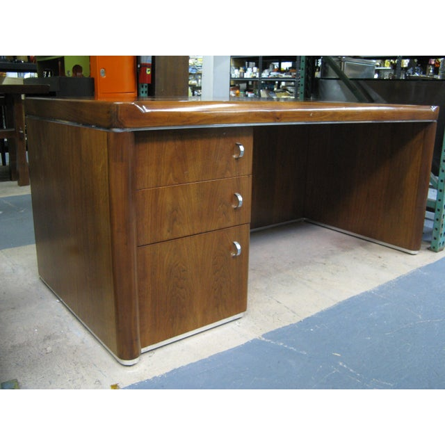 Beautiful Art Deco 1930s desk. The desk is made of rich walnut with exquisite grain and has a sleek streamline design with...