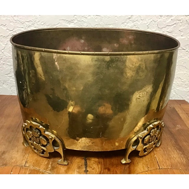 Vintage brass footed planter with Prince of Wales feathers in each foot. Marked of the bottom Made in England. Hand made...