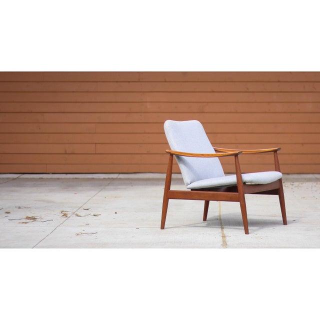 Finn Juhl Model 138 lounge chair. Designed by Finn Juhl, circa 1953. Made by France & Søn and imported by Jon Stuart. Teak...