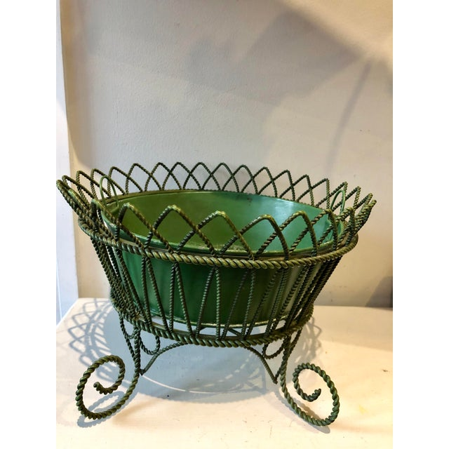 Gorgeous French flea market find handmade wrought twisted iron Army green painted footed planter stand and tin liner.
