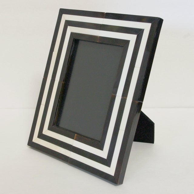 White and black horn photo frame Depth: 6.5 inches / Width: 8.5 inches / Height: 9.5 inches Photo Size: 5 inches by 7...