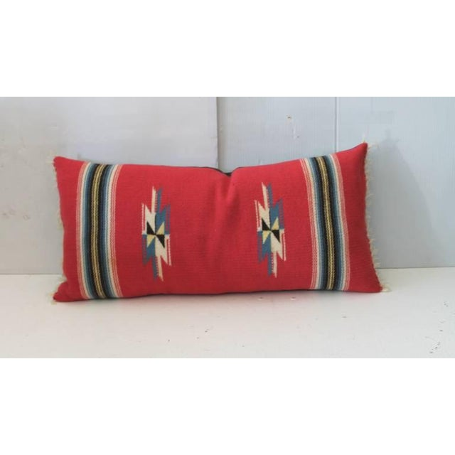 This is a wonderful red ground Mexican Indian weaving or serape in great condition. The backing is in a black cotton linen...