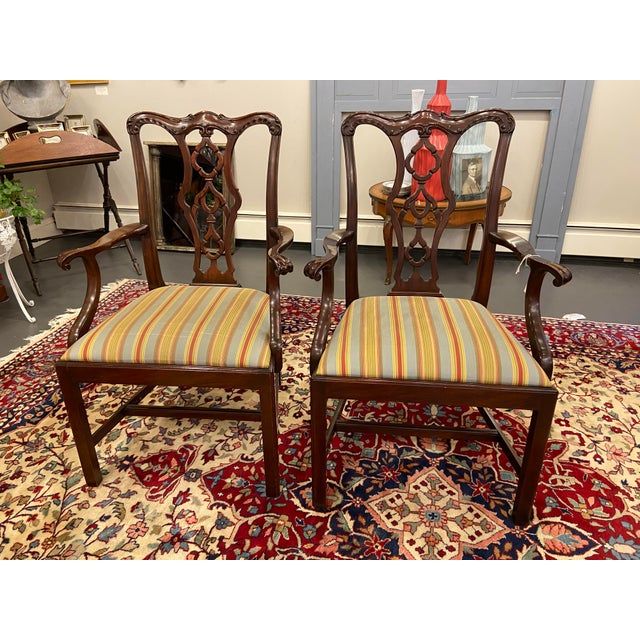 These are a beautiful pair of Henkel Harris armchairs. They are mahogany chairs from the 20th century. Their striped...