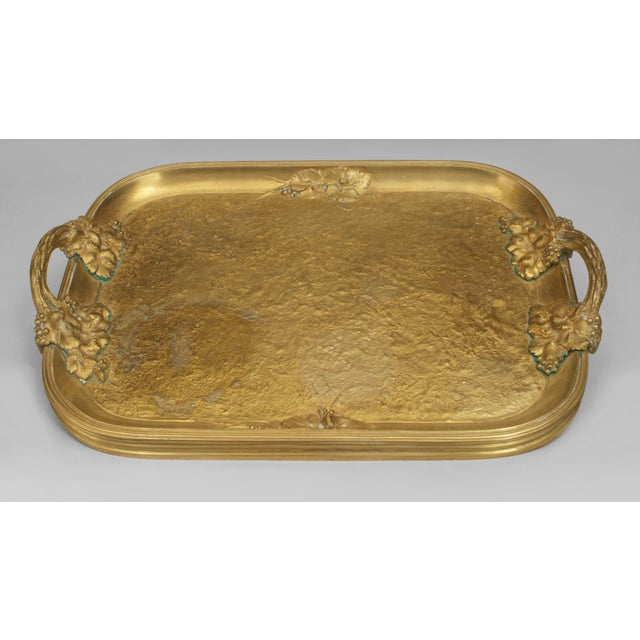 French Art Nouveau gilt bronze serving tray with side handles and floral design with a fluted edge (signed: MARIONNET)