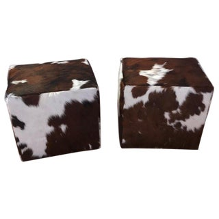 Pair of Cow Hide Benches or Ottomans For Sale