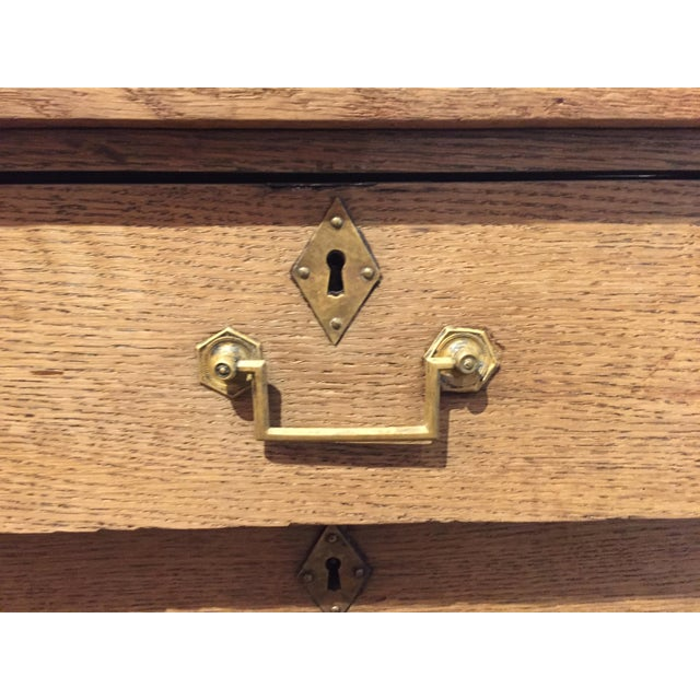 Beautiful petite French oak empire chest with three drawers. Nice details with original brass pulls and escutcheons, has a...