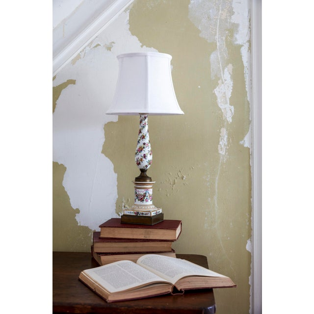 This small Dresden style lamp is a great size for beside the bed or a small table. The floral motif runs the length of the...