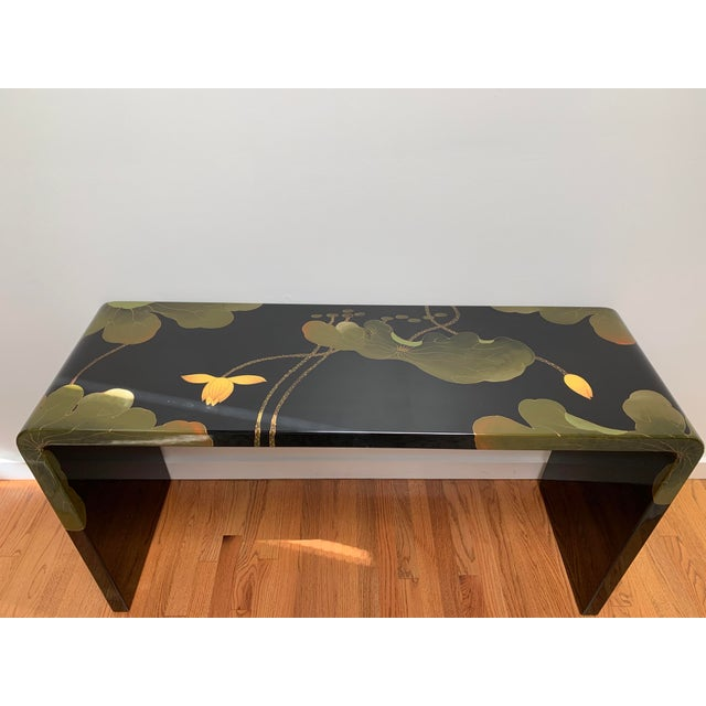 Stunning waterfall console table covered in a large-scale Asian lily pad and lotus leaf motif that appears to be lacquered...