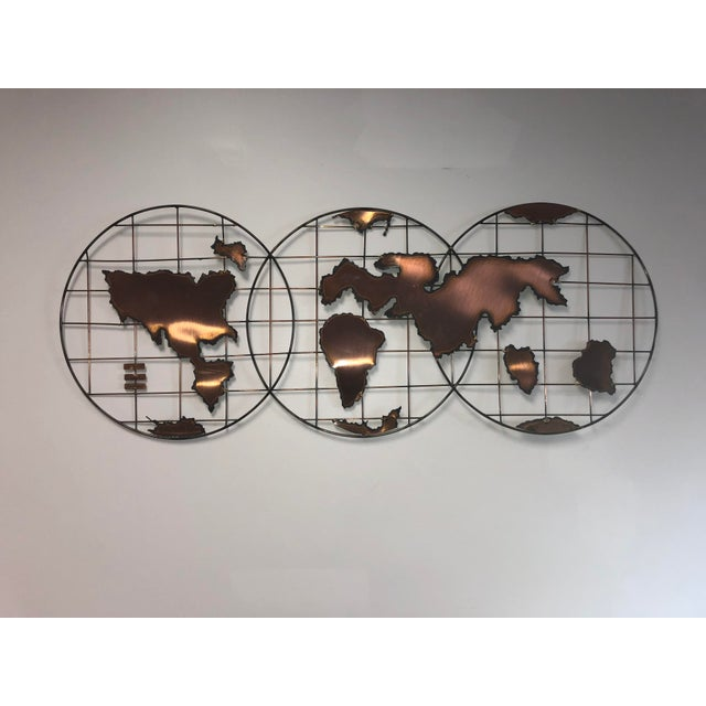 """Hand-welded sculptural wall hanging made of solid copper. Features an outline of the """"olde world"""" in 2-D within three..."""