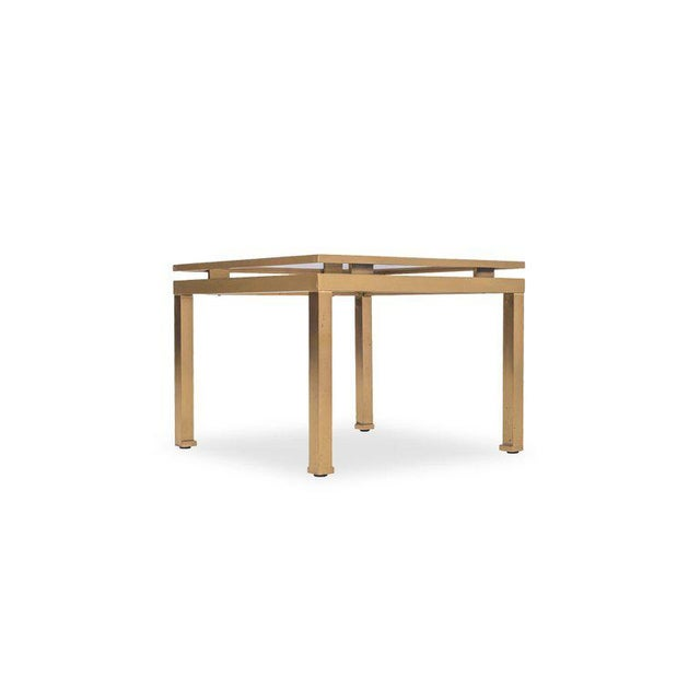 Hollywood Regency brass side tables with a modern square frame. The tables are fitted with a smoked glass table top that...