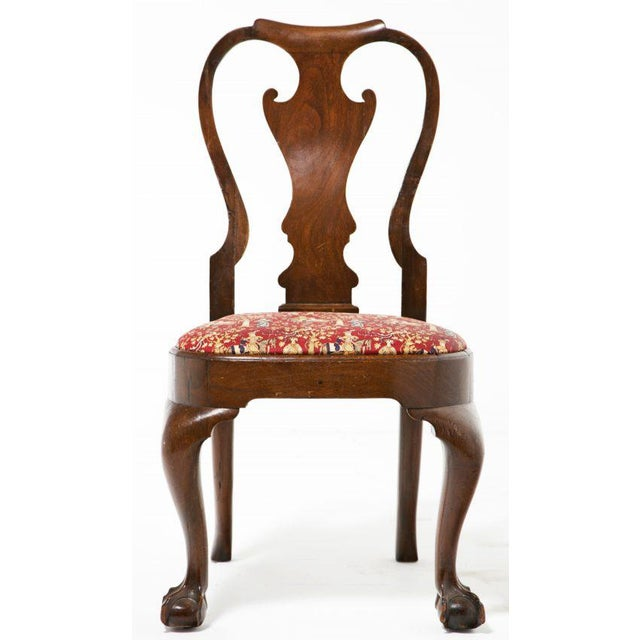An English George I – George II side chair with ball and claw feet. Matching arm chair also available.