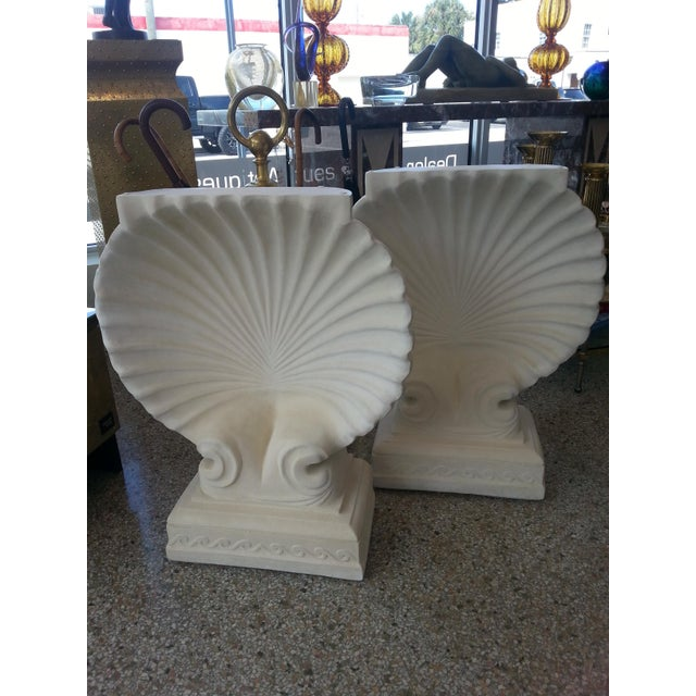 This stylish pair of clam shell console table bases could be also used as a dining table base. The pieces are cast plaster...