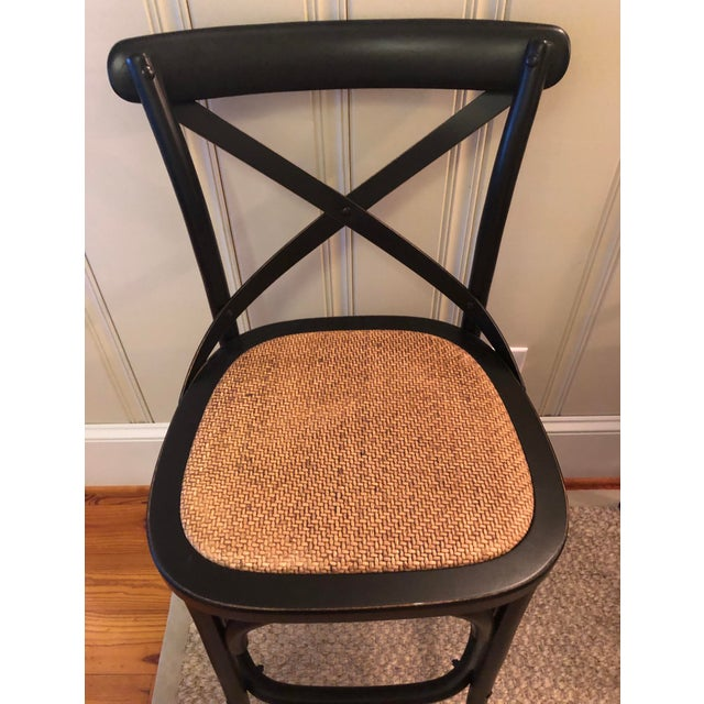 Brand new, unused set of 4 counter stools made by Furniture Classics. Frame is wood in black finish. Seat is rattan. These...